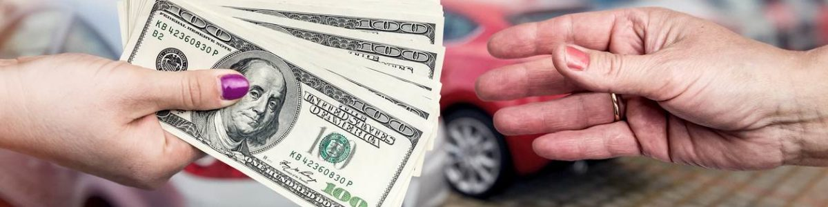 Closeup on hands with dollar, business deal with car